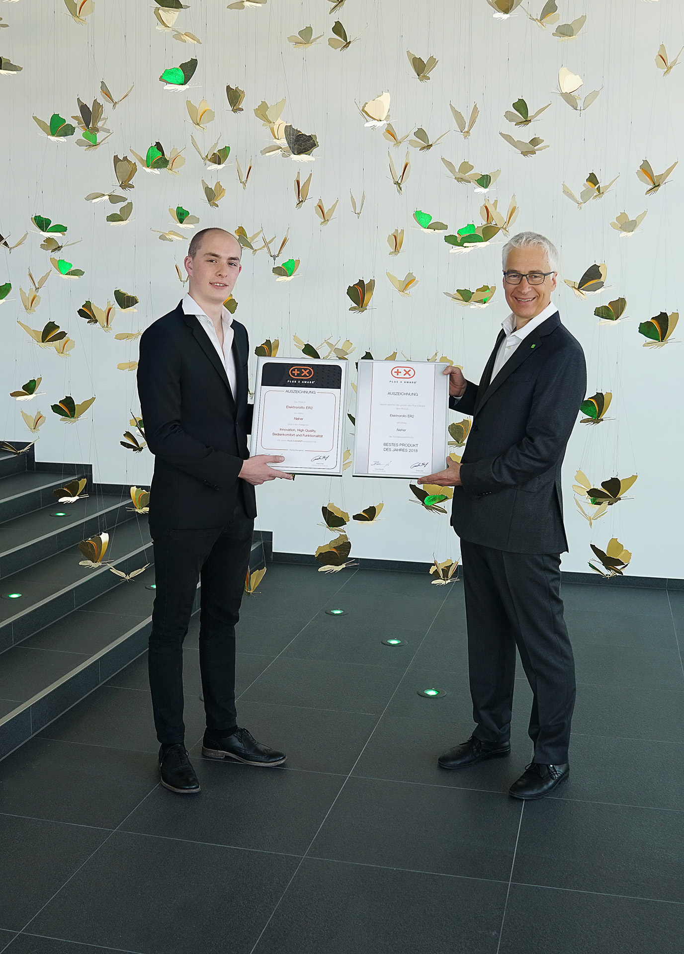 Neher receives Plus Xaward 2018 certificate presentation